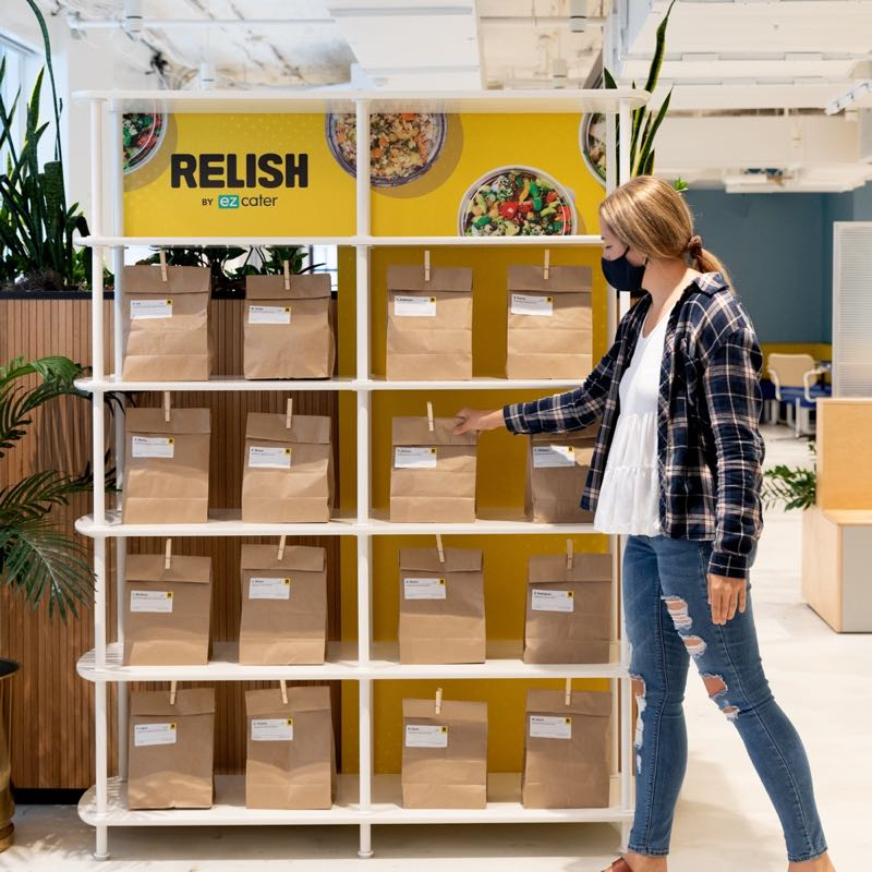 Person taking meal from a Relish shelf